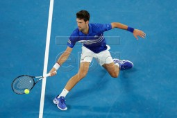 Novak Djokovic of Serbia in action during his men's singles second round match against Jo-Wilfried Tsonga of France at the Australian Open Grand Slam tennis tournament in Melbourne, Australia, 17 January 2019.  EPA-EFE/MAST IRHAM