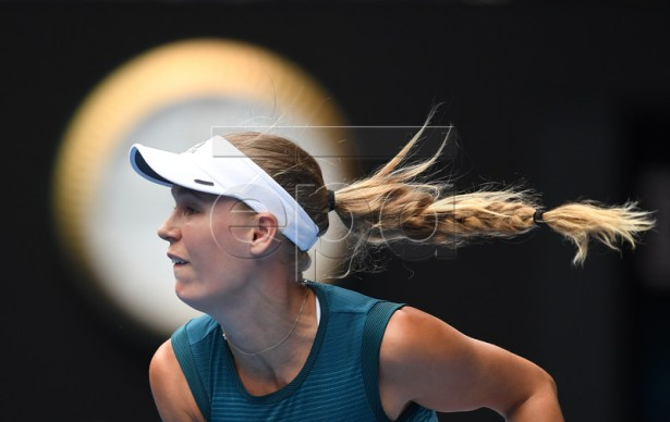 Caroline Wozniacki of Denmark in action against Maria Sharapova of Russia during their women's singles match on day five of the Australian Open Grand Slam tennis tournament in Melbourne, Australia, 18 January 2019. EPA-EFE/LUKAS COCH EDITORIAL USE ONLY AUSTRALIA AND NEW ZEALAND OUT