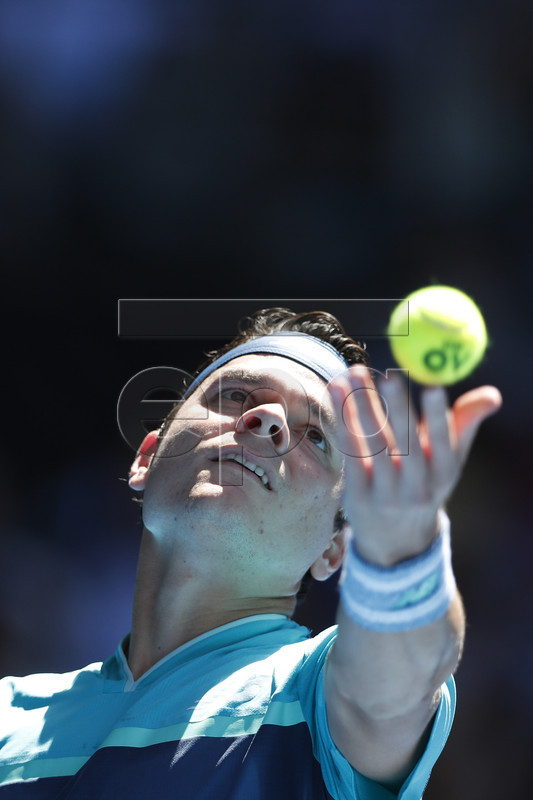 Milos Raonic of Canada in action against Pierre-Hugues Herbert of France during their round three men's singles match at the Australian Open Grand Slam tennis tournament in Melbourne, Australia, 19 January 2019. EPA-EFE/RITCHIE TONGO