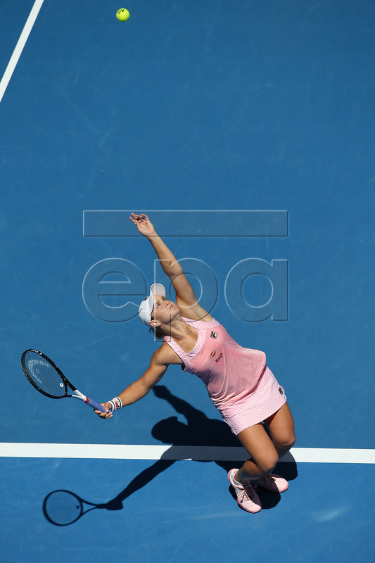 Ashleigh Barty of Australia in action against Maria Sharapova of Russia during their round four women's singles match on day seven of the Australian Open Grand Slam tennis tournament in Melbourne, Australia, 20 January 2019.  EPA-EFE/HAMISH BLAIR  AUSTRALIA AND NEW ZEALAND OUT