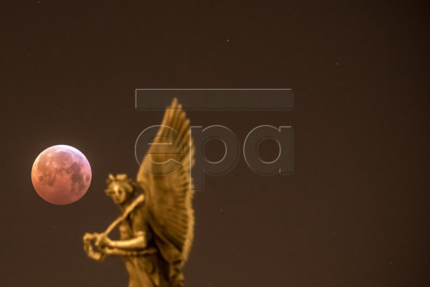 The so-called 'Super Blood Wolf Moon' is seen over city center in Prague, Czech Republic, 21 January 2019. The entire lunar eclipse was visible from North and South America, as well as parts of western Europe and north Africa.  EPA-EFE/MARTIN DIVISEK