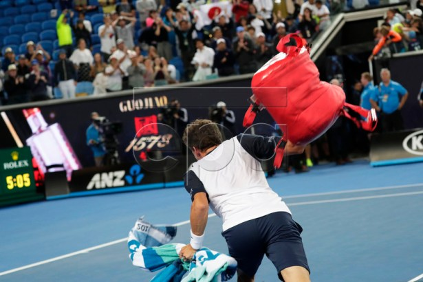 Pablo Carreno Busta of Spain throws his bag after losing his men's singles fourth round match against Kei Nishikori of Japan at the Australian Open Grand Slam tennis tournament in Melbourne, Australia, 21 January 2019. EPA-EFE/LYNN BO BO
