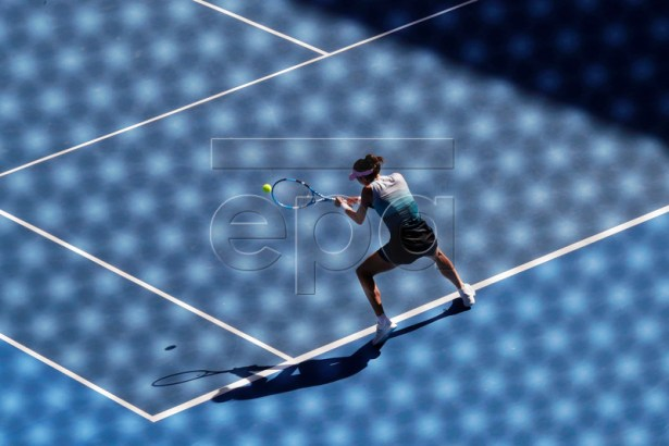 Garbine Muguruza of Spain in action during her women's singles fourth round match against Karolina Pliskova of the Czech Republic at the Australian Open Grand Slam tennis tournament in Melbourne, Australia, 21 January 2019. EPA-EFE/LYNN BO BO