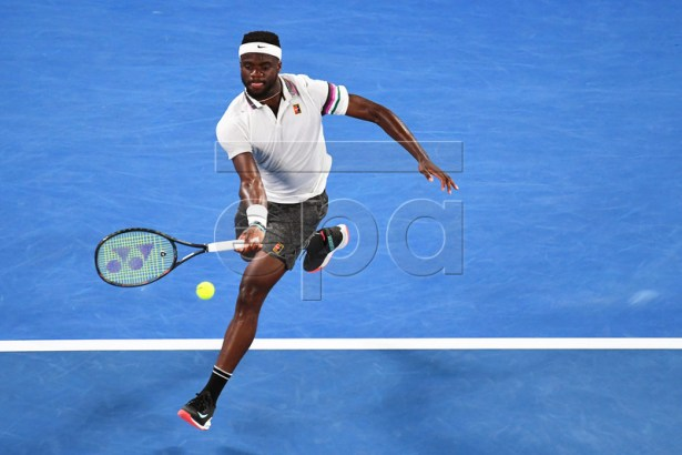 Frances Tiafoe of the USA in action against Rafael Nadal of Spain during their men's singles quarter final match of the Australian Open Grand Slam tennis tournament in Melbourne, Australia, 22 January 2019.  EPA-EFE/JULIAN SMITH AUSTRALIA AND NEW ZEALAND OUT