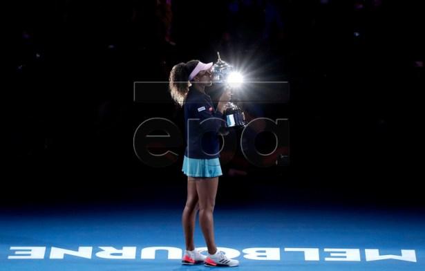 Naomi Osaka of Japan poses for photos with her trophy after winning the women's singles final match against Petra Kvitova of Czech Republic at the Australian Open Grand Slam tennis tournament in Melbourne, Australia, 26 January 2019.  EPA-EFE/LYNN BO BO