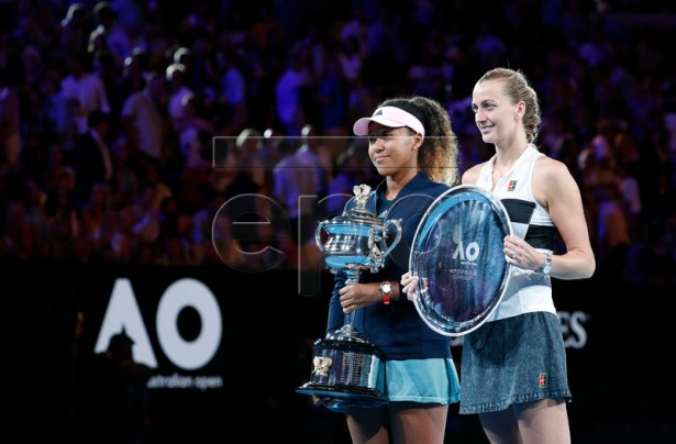 Naomi Osaka (L) of Japan and Petra Kvitova (R) of Czech Republic pose for photos with their trophies after their women's singles final match against Petra Kvitova of Czech Republic at the Australian Open Grand Slam tennis tournament in Melbourne, Australia, 26 January 2019.  EPA-EFE/RITCHIE TONGO