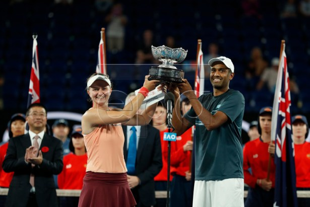 Rajeev Ram (L) of USA and Barbora Krejcikova (L) of Czech Republic pose with their trophy after winning their mixed doubles final match against John-Patrick Smith of Australia and Astra Sharma of Australia at the Australian Open Grand Slam tennis tournament in Melbourne, Australia, 26 January 2019.  EPA-EFE/RITCHIE TONGO