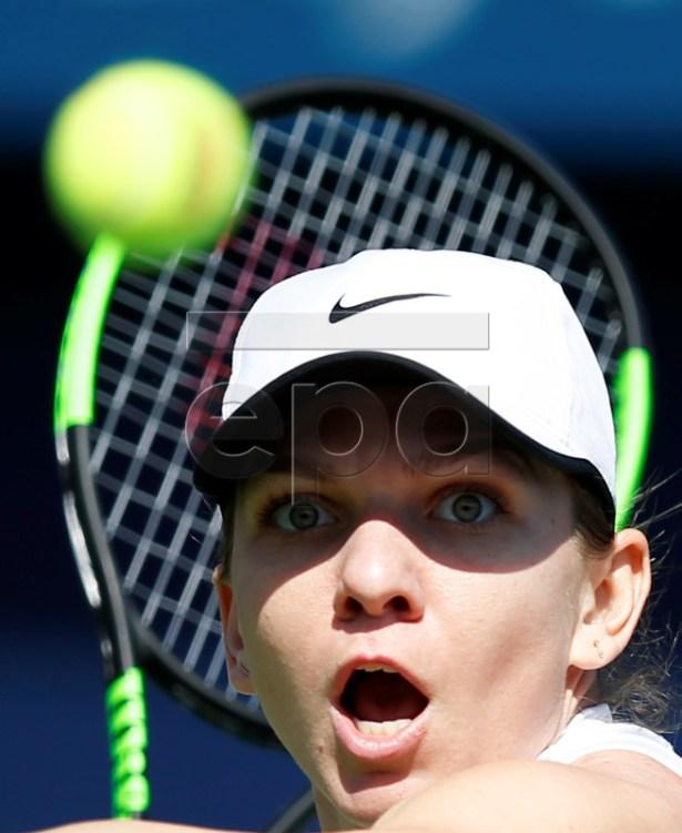 Simona Halep of Romania in action against Lesia Tsurenko of Ukraine during their third round match of the Dubai Duty Free Tennis WTA Championships 2019 in Dubai, United Arab Emirates, 20 February 2019.  EPA-EFE/ALI HAIDER