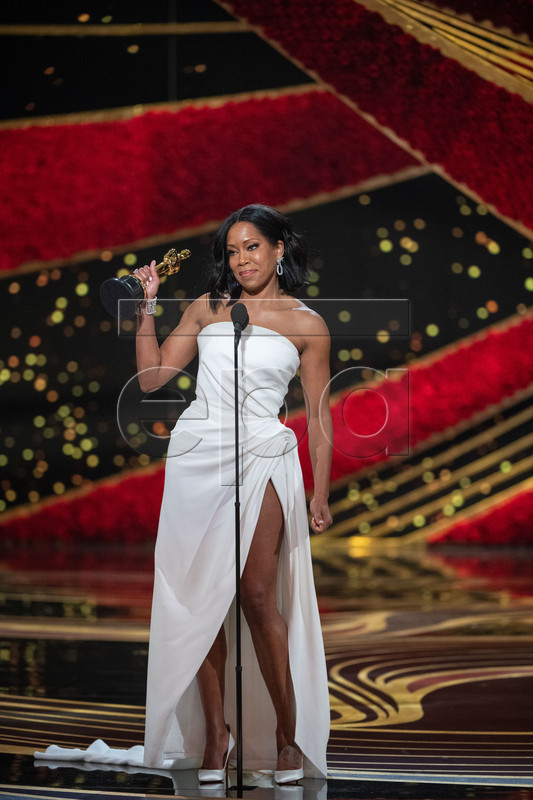 A handout photo made available by the Academy of Motion Picture Arts and Science (AMPAS) shows Regina King accepting the Oscar for performance by an actress in a supporting role during the 91st annual Academy Awards ceremony at the Dolby Theatre in Hollywood, California, USA, 24 February 2019. The Oscars are presented for outstanding individual or collective efforts in 24 categories in filmmaking. EPA-EFE/Aaron Poole / AMPAS / HANDOUT THE IMAGE MAY NOT BE ALTERED AND IS FREE FOR EDITORIAL USE ONY IN REPORTING ABOUT THE EVENT. ONE TIME USE ONLY. MANDATORY CREDIT. HANDOUT EDITORIAL USE ONLY/NO SALES