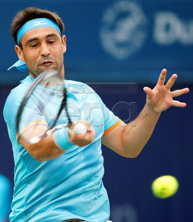 Marcos Baghdatis of Cyprus in action against Gael Monfils of France during their second round match at the Dubai Duty Free Tennis ATP Championships 2019 in Dubai, United Arab Emirates, 27 February 2019. EPA-EFE/ALI HAIDER
