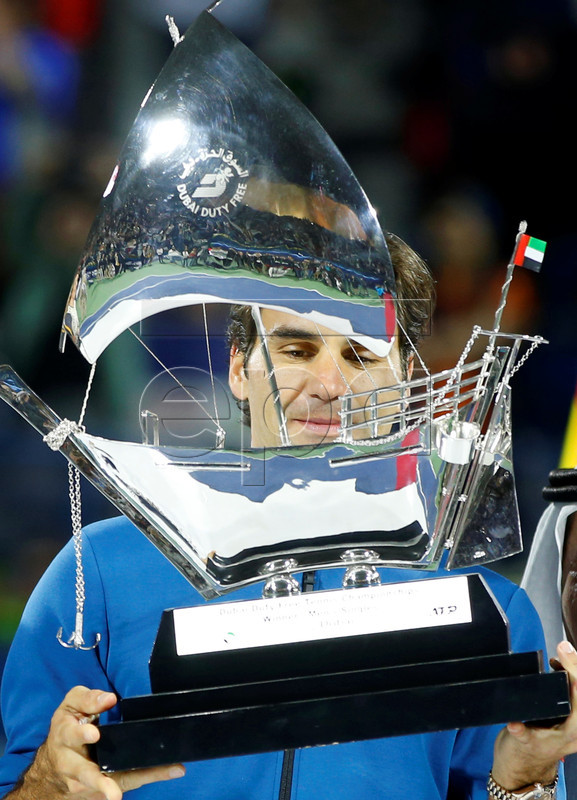Roger Federer of Switzerland looks at his trophy after defeating Stefanos Tsitsipas of Greece in their final match at the Dubai Duty Free Tennis ATP Championships 2019 in Dubai, United Arab Emirates, 02 March 2019.  EPA-EFE/ALI HAIDER