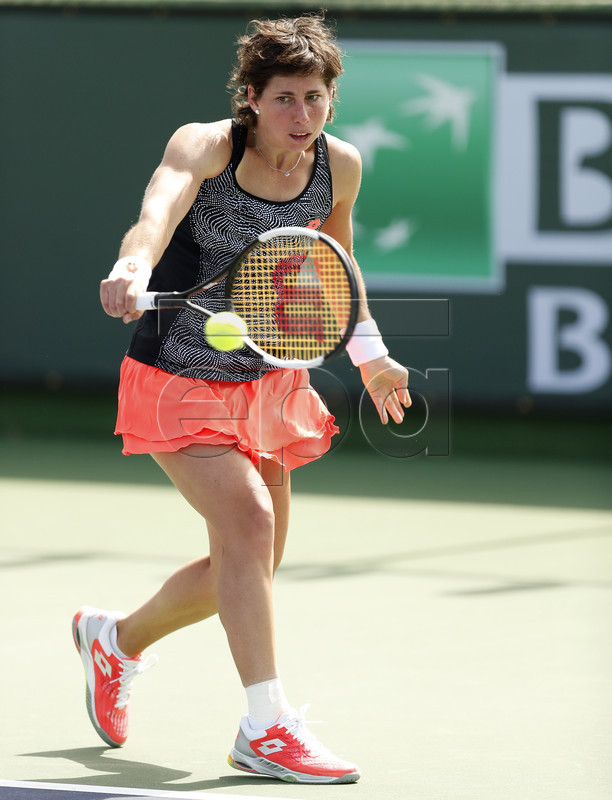 Carla Suarez Navarro of Spain in action against Natalia Vikhlyantseva of Russia during the BNP Paribas Open tennis tournament at the Indian Wells Tennis Garden in Indian Wells, California, USA, 09 March 2019. The men's and women's final will be played, 17 March 2019.  EPA-EFE/JOHN G. MABANGLO
