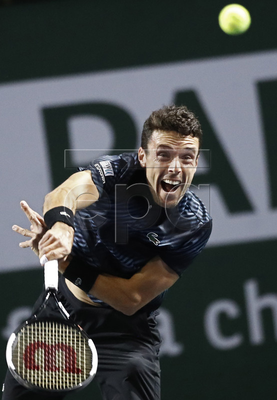 Roberto Bautista Agut of Spain in action against Yoshihito Nishioka of Japan during the BNP Paribas Open tennis tournament at the Indian Wells Tennis Garden in Indian Wells, California, USA, 09 March 2019. The men's and women's final will be played on 17 March 2019.  EPA-EFE/LARRY W. SMITH