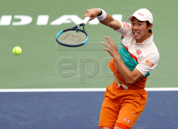 Kei Nishikori of Japan in action against Hubert Hurkacz of Poland during the BNP Paribas Open tennis tournament at the Indian Wells Tennis Garden in Indian Wells, California, USA, 12 March 2019. The men's and women's final will be played, 17 March 2019.  EPA-EFE/JOHN G. MABANGLO
