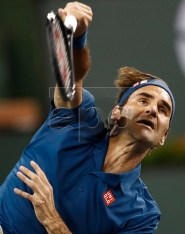 Roger Federer of Switzerland in action against Stan Wawrinka of Switzerland during the BNP Paribas Open tennis tournament at the Indian Wells Tennis Garden in Indian Wells, California, USA, 12 March 2019. The men's and women's final will be played, 17 March 2019.  EPA-EFE/LARRY W. SMITH