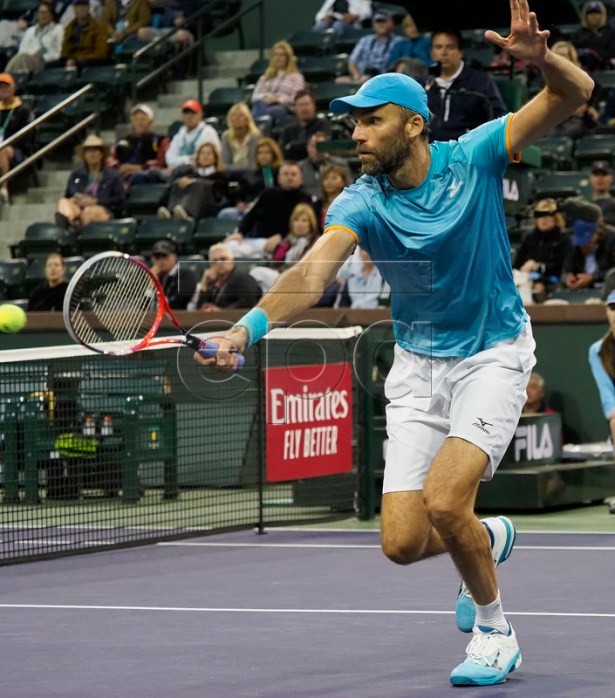 Ivo Karlovic of Croatia in action against Dominic Thiem of Austria during the BNP Paribas Open tennis tournament at the Indian Wells Tennis Garden in Indian Wells, California, USA, 13 March 2019. The men's and women's final will be played, 17 March 2019.  EPA-EFE/JOHN G. MABANGLO