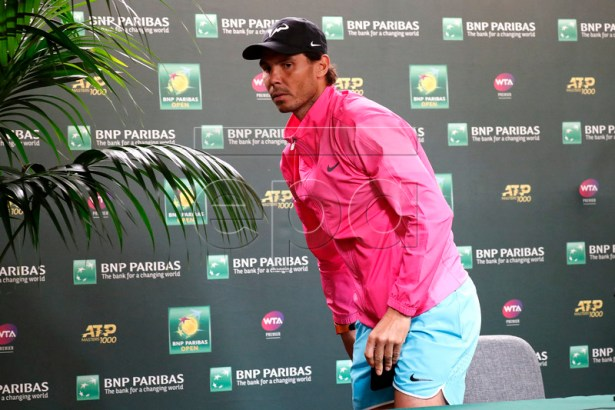 Rafael Nadal of Spain gets up to leave the press conference after announcing his withdrawal from his semifinal match against Roger Federer of Switzerland during the BNP Paribas Open tennis tournament at the Indian Wells Tennis Garden in Indian Wells, California, USA, 16 March 2019. The men's and women's final will be played, 17 March 2019.  EPA-EFE/JOHN G. MABANGLO