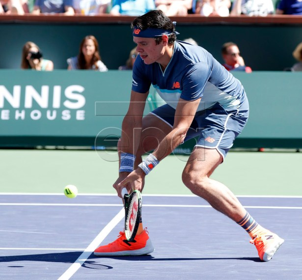 Milos Raonic of Canada in action against Dominic Thiem of Austria during the BNP Paribas Open tennis tournament at the Indian Wells Tennis Garden in Indian Wells, California, USA, 16 March 2019. The men's and women's final will be played, 17 March 2019.  EPA-EFE/JOHN G. MABANGLO