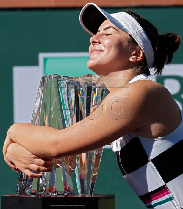 Bianca Andreescu of Canada hugs the trophy after winning against Angelique Kerber of Germany during the Finals at the BNP Paribas Open tennis tournament at the Indian Wells Tennis Garden in Indian Wells, California, USA, 17 March 2019.  EPA-EFE/JOHN G MABANGLO