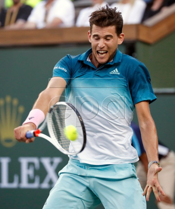Dominic Thiem of Austria in action against Roger Federer of Switzerland during the BNP Paribas Open tennis tournament at the Indian Wells Tennis Garden in Indian Wells, California, USA, 17 March 2019.  EPA-EFE/JOHN G. MABANGLO