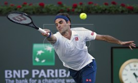 Roger Federer of Switzerland in action against Dominic Thiem of Austria during the Men's Final at the BNP Paribas Open tennis tournament at the Indian Wells Tennis Garden in Indian Wells, California, USA, 17 March 2019.  EPA-EFE/RAY ACEVEDO
