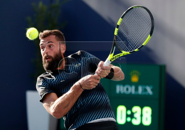 Benoit Paire of France in action against Feliciano Lopez of Spain during their match at the Miami Open tennis tournament in Miami, Florida, USA, 21 March 2019.  EPA-EFE/JASON SZENES