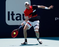 John Isner of the US in action against Albert Ramos Vinolas of Spain during their men's singles match at the Miami Open tennis tournament in Miami, Florida, USA, 24 March 2019. EPA-EFE/JASON SZENES