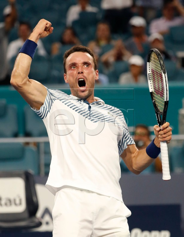 Roberto Bautista Agut of Spain reacts after defeating Novak Djokovic of Serbia following their men's singles match at the Miami Open tennis tournament in Miami, Florida, USA, 26 March 2019.  EPA-EFE/RHONA WISE