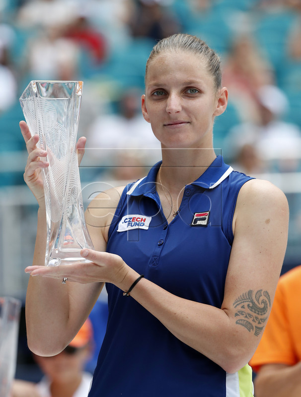 Karolina Pliskova of The Czech Republic holds her runner-up trophy after being defeated by Ashleigh Barty of Australia following their women's finals match at the Miami Open tennis tournament in Miami, Florida, USA, 30 March 2019.  EPA-EFE/RHONA WISE