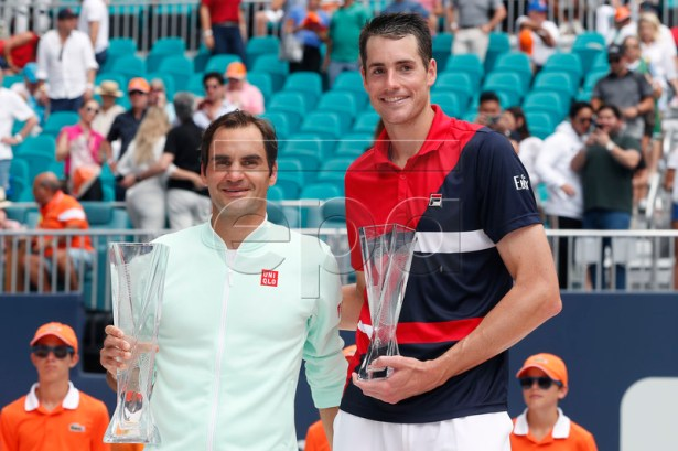Roger Federer of Switzerland (L) and John Isner of the US (R) pose for a photo following their Men's finals match at the Miami Open tennis tournament in Miami, Florida, USA, 31 March 2019.  EPA-EFE/RHONA WISE