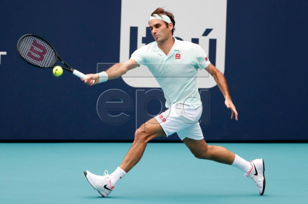 Roger Federer of Switzerland in action against John Isner of the US during their Men's finals match at the Miami Open tennis tournament in Miami, Florida, USA, 31 March 2019.  EPA-EFE/RHONA WISE