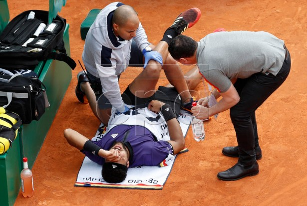 Jo-Wilfried Tsonga of France is treated during his first round match against Taylor Fritz of US at the Monte-Carlo Rolex Masters tournament in Roquebrune Cap Martin, France, 16 April 2019. Jo-Wilfried Tsonga retired for injury.  EPA-EFE/SEBASTIEN NOGIER
