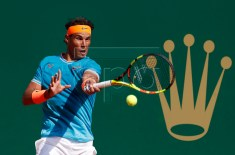 Rafael Nadal of Spain returns the ball to Guido Pella of Argentina during their quarter final match at the Monte-Carlo Rolex Masters tournament in Roquebrune Cap Martin, France, 19 April 2018.  EPA-EFE/SEBASTIEN NOGIER