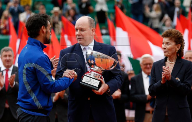 Fabio Fognini of Italy (L) poses with his trophy next to Prince Albert II of Monaco (C) and Monegasque Tennis Federation Elisabeth-Anne de Massy (R) after his final match against and Dusan Lajovic of Serbia at the Monte-Carlo Rolex Masters tournament in Roquebrune Cap Martin, France, 21 April 2019.  EPA-EFE/SEBASTIEN NOGIER