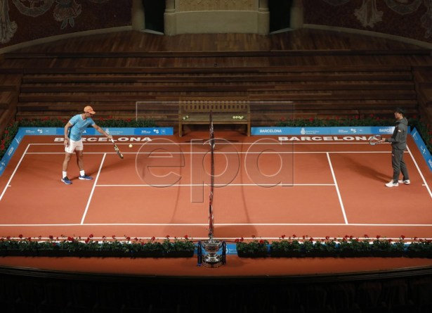 Spanish tennis player Rafael Nadal (L) and Kei Nishikori (R) of Japan warm up during a press preview on occasion of the presentation of the 67th Barcelona Open Trofeo Conde de Godo tennis tournament at the Catalan Music Palace in Barcelona, Spain, 22 April 2019. The arcelona Open Trofeo Conde de Godo tennis tournament 2019 will be played in Barcelona from 20 until 28 April 2019.  EPA-EFE/Andreu Dalmau