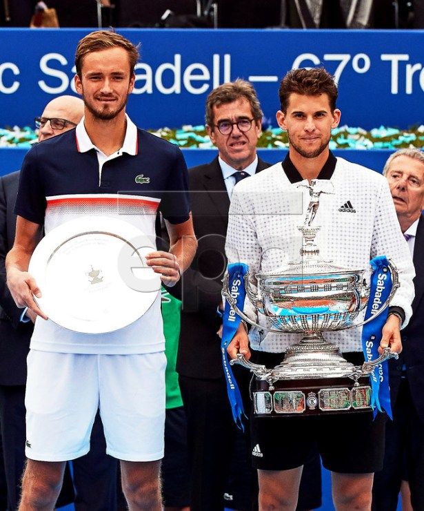 Dominic Thiem (R) of Austria poses with his trophy after defeating Daniil Medvedev (L) of Russia in their final match of the 67th Barcelona Open Trofeo Conde de Godo tennis tournament in Barcelona, Spain, 28 April 2019.  EPA-EFE/ALEJANDRO GARCIA