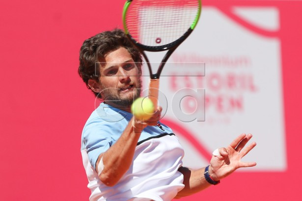 Pedro Sousa from Portugal in action during his first round match against Rilley Opelka of the USA at the Estoril Open Tennis tournament in Cascais, on the outskirts of Lisbon, Portugal, 29 April 2019.  EPA-EFE/JOSE SENA GOULAO