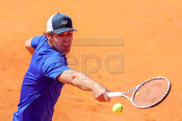 Reilly Opelka of the USA in action against Gael Monfils of France during their second round match at the Estoril Open tennis tournament in Cascais, near Lisbon, Portugal, 01 May 2019.  EPA-EFE/JOSE SENA GOULAO