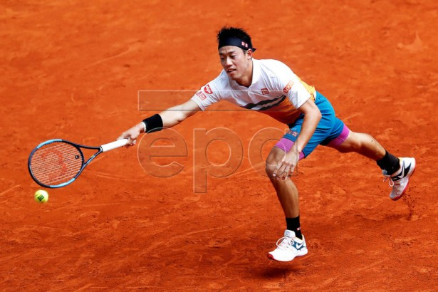Kei Nishikori of Japan in action against Hugo Dellien of Bolivia during their second round match of the Mutua Madrid Open tennis tournament at the Caja Magica complex in Madrid, Spain, 08 May 2019.  EPA-EFE/CHEMA MOYA