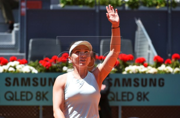 Simona Halep of Romania celebrates after defeating Ashleigh Barty of Australia in their quarter final match of the Mutua Madrid Open tennis tournament at the Caja Magica complex in Madrid, Spain, 09 May 2019.  EPA-EFE/FERNANDO VILLAR