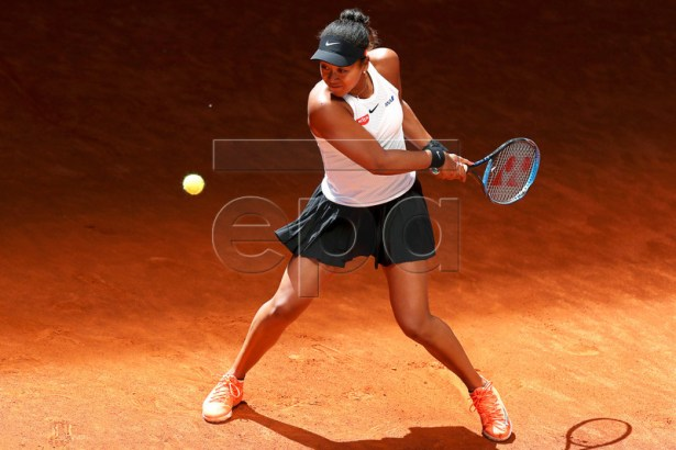 Naomi Osaka of Japan in action against Belinda Bencic of Switzerland during their quarter final match of the Mutua Madrid Open tennis tournament at the Caja Magica complex in Madrid, Spain, 09 May 2019.  EPA-EFE/KIKO HUESCA