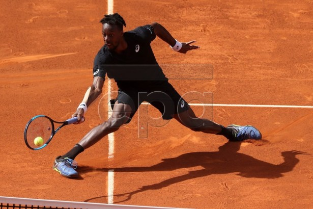 Gael Monfils of France in action against Roger Federer of Switzerland during their third round match of the Mutua Madrid Open tennis tournament at the Caja Magica complex in Madrid, Spain, 09 May 2019.  EPA-EFE/Kiko Huesca