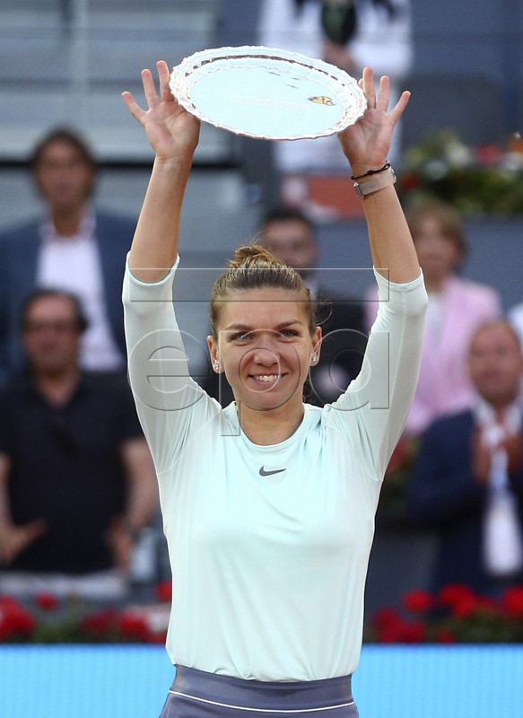 Simona Halep of Romania shows her runner-up throphy after losing against Kiki Bertens of Netherlands during their Mutua Madrid Open tennis final game at Caja Magica, in Madrid, Spain, 11 May 2019.  EPA-EFE/Rodrigo Jimenez