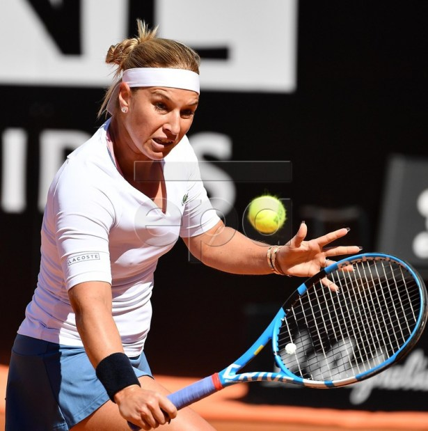 Dominika Cibulkova of Slovakia in action against Naomi Osaka of Japan during their women's singles second round match at the Italian Open tennis tournament in Rome, Italy, 16 May 2019.  EPA-EFE/ETTORE FERRARI