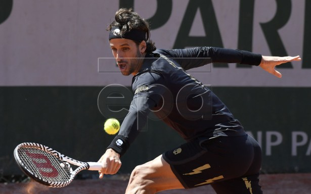 Feliciano Lopez of Spain plays Ivo Karlovic of Croatia during their men?s first round match during the French Open tennis tournament at Roland Garros in Paris, France, 28 May 2019. EPA-EFE/JULIEN DE ROSA