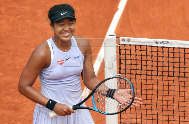 Naomi Osaka of Japan reacts after winning against Victoria Azarenka of Belarus their women?s second round match during the French Open tennis tournament at Roland Garros in Paris, France, 30 May 2019. EPA-EFE/SRDJAN SUKI
