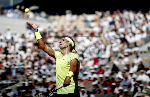 Rafael Nadal of Spain serves to Juan Ignacio Londero of Argentina during their men?s round of 16 match during the French Open tennis tournament at Roland Garros in Paris, France, 02 June 2019. EPA-EFE/YOAN VALAT