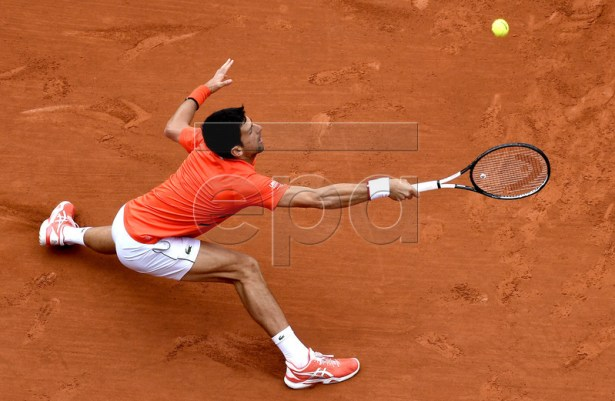 Novak Djokovic of Serbia plays Jan-Lennard Struff of Germany during their men?s round of 16 match during the French Open tennis tournament at Roland Garros in Paris, France, 03 June 2019. EPA-EFE/JULIEN DE ROSA