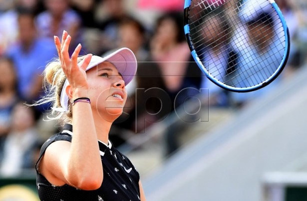 Amanda Anisimova of the USA reacts as she plays Aliona Bolsova of Spain during their women?s round of 16 match during the French Open tennis tournament at Roland Garros in Paris, France, 03 June 2019. EPA-EFE/CAROLINE BLUMBERG