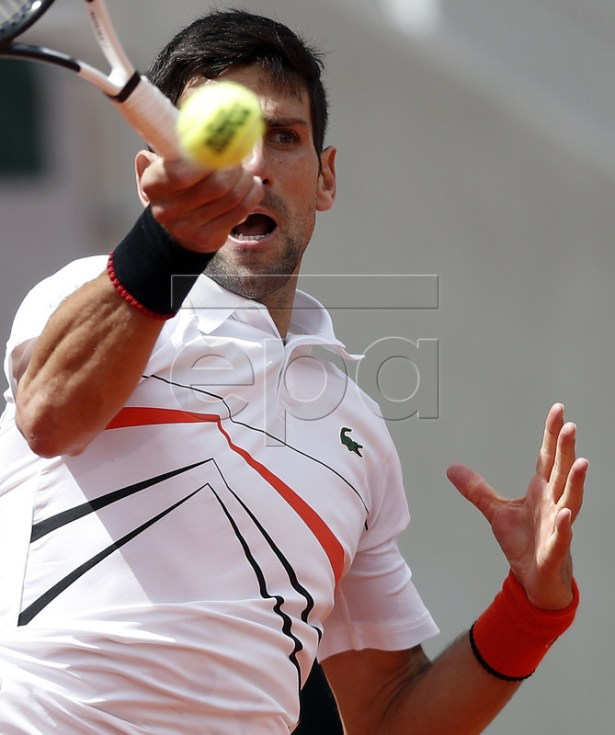 Novak Djokovic of Serbia plays Dominic Thiem of Austria during their men?s semi final match during the French Open tennis tournament at Roland Garros in Paris, France, 08 June 2019. EPA-EFE/YOAN VALAT